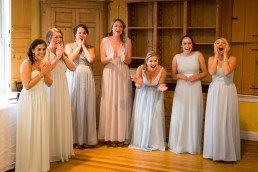 bridesmaids first look at bride by Vermont wedding photographer