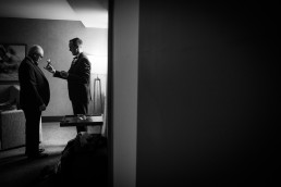 Black and white groom getting ready black and white candid photographer from Vermont