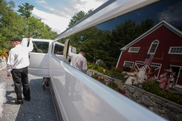 bride getting into limo at inn at grace farm in vermont
