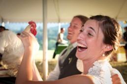 vermont bride holding chicken at wedding reception in woodstock vermont