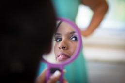 reflection of black bride in hand mirror