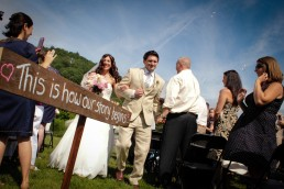 wooden wedding signage with bride and groom recessional in Richmond Vermont