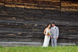 wedding couple portrait in front of barn texture in Starksboro, Vermont