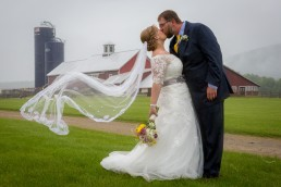 Wedding couple portrait with epic veil at Boyden Barn in Cambridge, Vermont