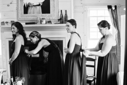 black and white image of bridesmaids getting ready for wedding ceremony