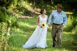 Bride and father walk to wedding ceremony in Woodstock, Vermont