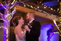 first dance at wedding reception couple under twinkly lights at Mountaintop Inn in Vermont