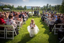 flower girl goes wrong way down aisle at Bolton, Vermont wedding ceremony