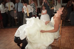 groom captures garter off bride at the Essex in Vermont