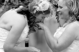 gay wedding ceremony candid kiss black and white image by Vermont Wedding Photographers
