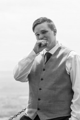grooms first look emotional and candid black and white image on Mount Philo, Vermont