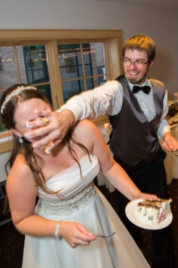 Jay Peak wedding, groom smashes cake in bride's face
