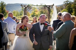 Wedding couple just married recessional at the Ponds in Bolton, Vermont
