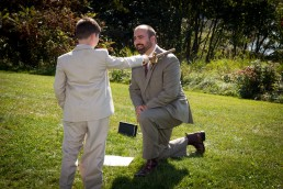 Ringbearer knighting groom at Button Bay State Park wedding ceremony