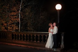 night time wedding portrait on slate bridge in fall of Vermont