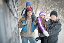 A lifestyle portrait of family snow shoeing in Vermont winter
