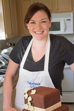 a personal branding portrait of a woman cake baker in kitchen