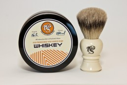 A detailed product image of whiskey shave soap and lather brush