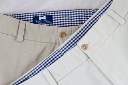A brand closeup image of Beau Ties Ltd. logo in khaki pants