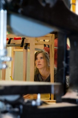 personal branding image of a woman woodworker contemplating design