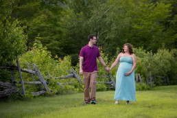A casual lifestyle maternity portrait of couple captured in Bolton, Vermont