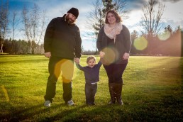 a creative lifestyle family portrait with sun flare in Hinesburg, Vermont