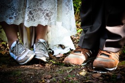 Wedding day details: sneakers in the woods of Vermont