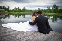 Quiet moment between wedding couple on dock at The Ponds in Bolton, Vermont