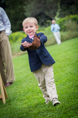 Vermont ring bearer with baseball mitt walks into ceremony at Catamount Outdoor Center in Vermont