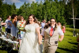 Gay couple just married wedding recessional at Sleepy Hollow in Vermont