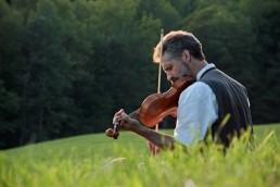 Violin in a field wedding ceremony in Woodstock, Vermont