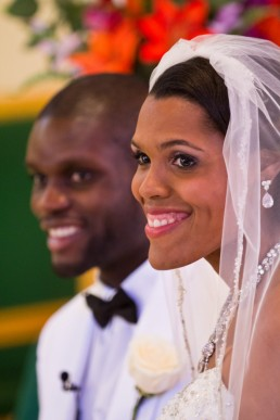 wedding ceremony in church of black couple smiling in Montpelier, Vermont