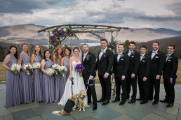 Wedding party group portrait with mountains in background at Mountaintop Inn in Vermont