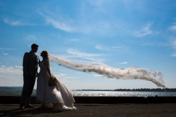 Bridal portrait of veil silhouettes and Lake Champlain in Saint Albans, Vermont