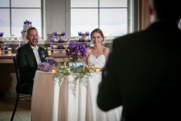 Candid couple wedding reception toasts reactions at Mountaintop Inn in Vermont