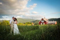 Portrait of couple in field at West Monitor Barn in Richmond Vermont