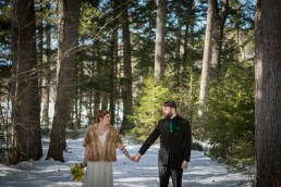 woodsy winter wedding portrait in Maine by Vermont wedding photographers
