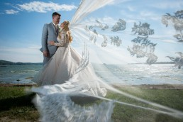 epic veil shot in Saint Albans Vermont by wedding photographers