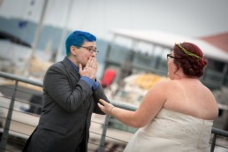emotional bride's first look on Lake Champlain in Vermont by candid wedding photographer