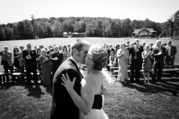 first kiss wedding ceremony at Mounaintop inn in Vermont black and white