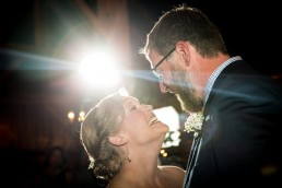 couple first dance at boyden farm in vermont with lens flare