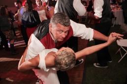 Fun wedding reception guest dancing in Vermont