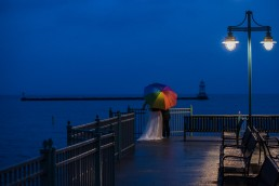 vermont gay wedding portrait with rainbow umbrella on Burlington waterfront