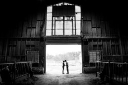 uvm barn engagement portrait in black and white
