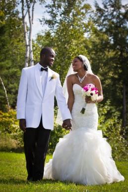 candid black wedding couple walking portrait in Montpelier, Vermont