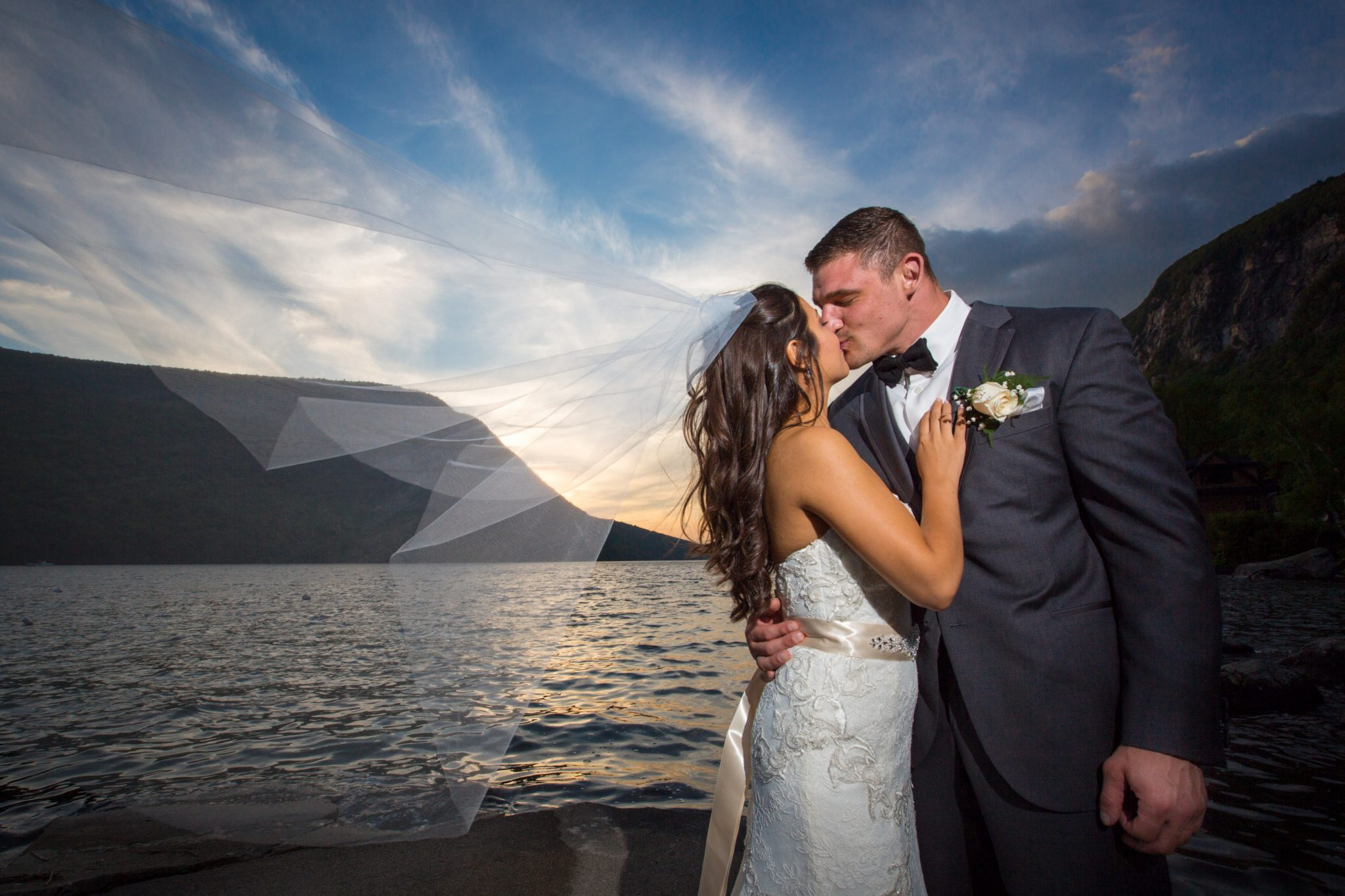 Candid kiss at sunset. A wedding portrait at The Notch House on Willoughby Lake