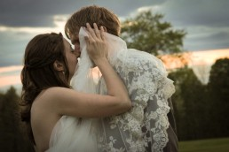 intimate and candid sunset kiss wedding portrait by Vermont wedding photographers