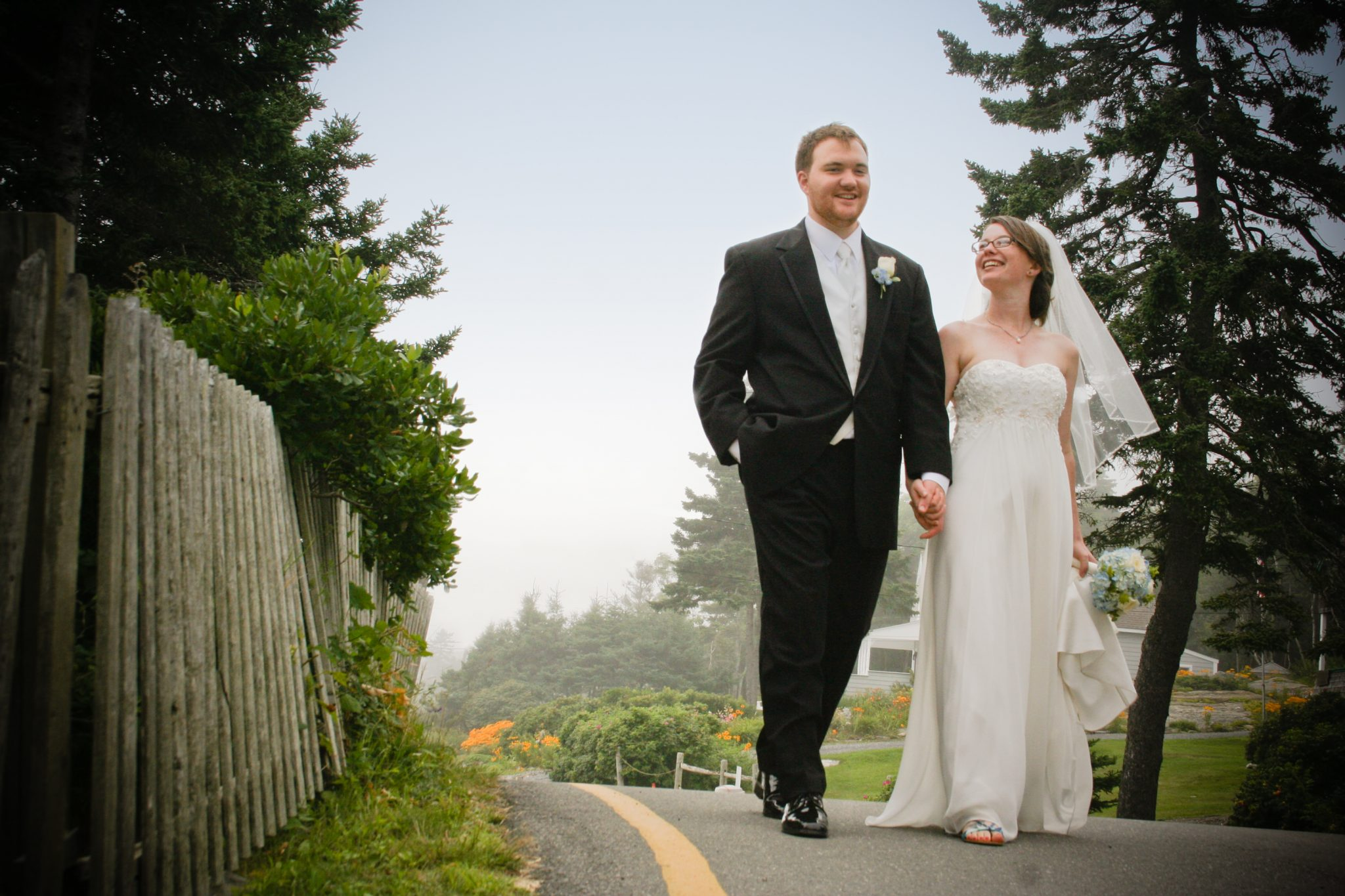 candid wedding couple walking in Maine by Vermont wedding photographers