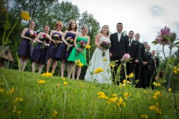 Candid wedding party in field of flowers at Sleepy Hollow in Vermont