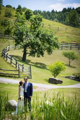 Environmental wedding portrait candid in Sharon Vermont
